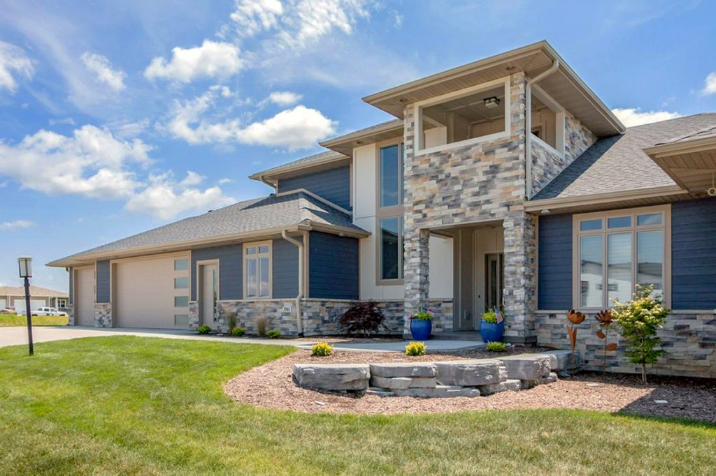 SGA Construction exterior completed home with blue and stone