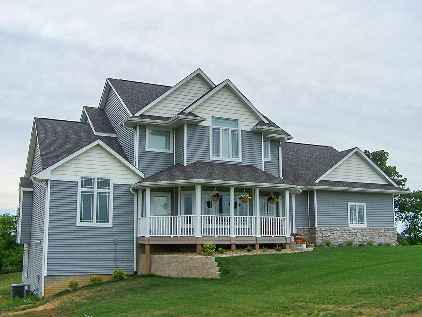 SGA Construction new home exterior view with porch and paneling